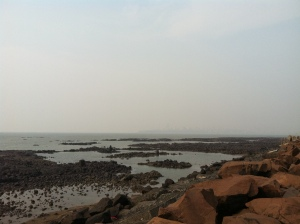 The beach at TIFR, looking north to the haze-obscured skyline of Mumbai